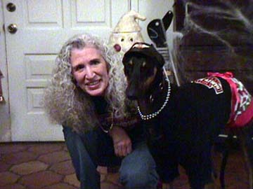 Maya, black Greyhound, and Charlotte dressed for a party in black t-shirts, silver necklaces and red miniskirts.