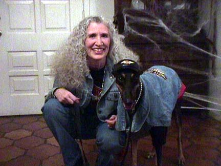 Maya, black Greyhound, and Charlotte dressed in Harley jackets and silver necklaces.